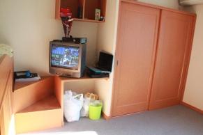 Closet, TV, and stairs